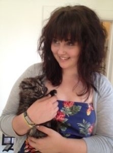 Hannah the student cuddles Tilly in the pet-sitter emergency