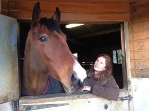 Sarah with Alex, one of the horses in her stable. HouseSitMatch house-sitting