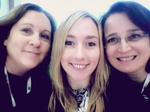 Three members of the HouseSit Match team pose for a selfie at the World Travel Market