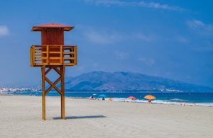 Photo of a beautiful beach scene with view tower