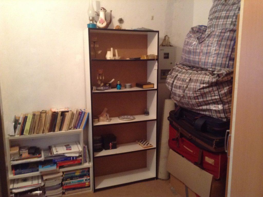 Long term housesitting - dusty bookshelves to be moved