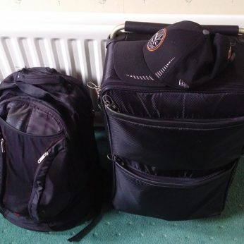 Two suitcases containing all portable possessions of a housesitter