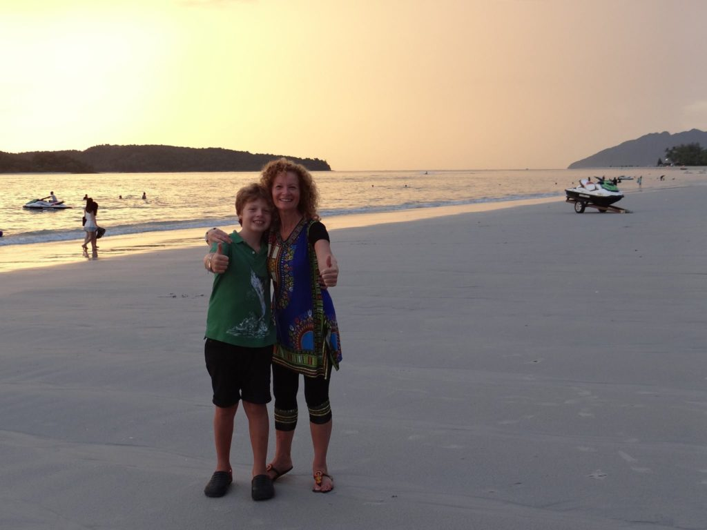 Mother and son travel together - on beach in Malaysia