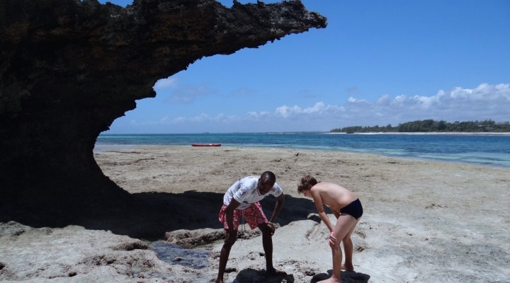 Louis learning about beach and marine life from a local Kenyan