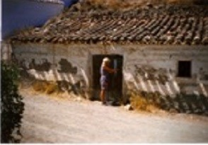 Anne, the author standing infront of the house in 1996
