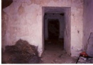 Cleared rubble piled in the corridor in 1996
