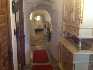 Corridor hewn out of the rock with cupboards and carpet