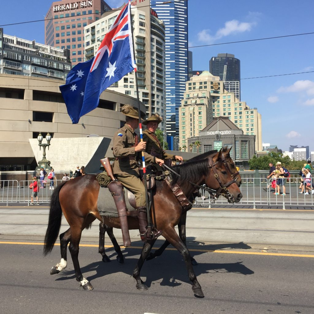 Traveling Australia seeing horses and flag bearers in Melbourne on Australia Day