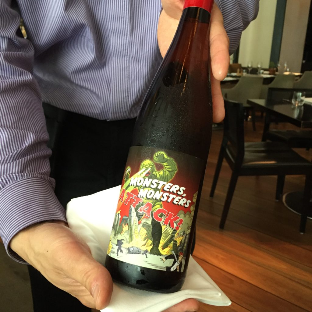 A bottle of Yarra white wine, amusing label says Monsters Attack