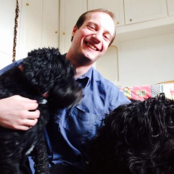 The dogs show David the dog-sitter a great deal of affection