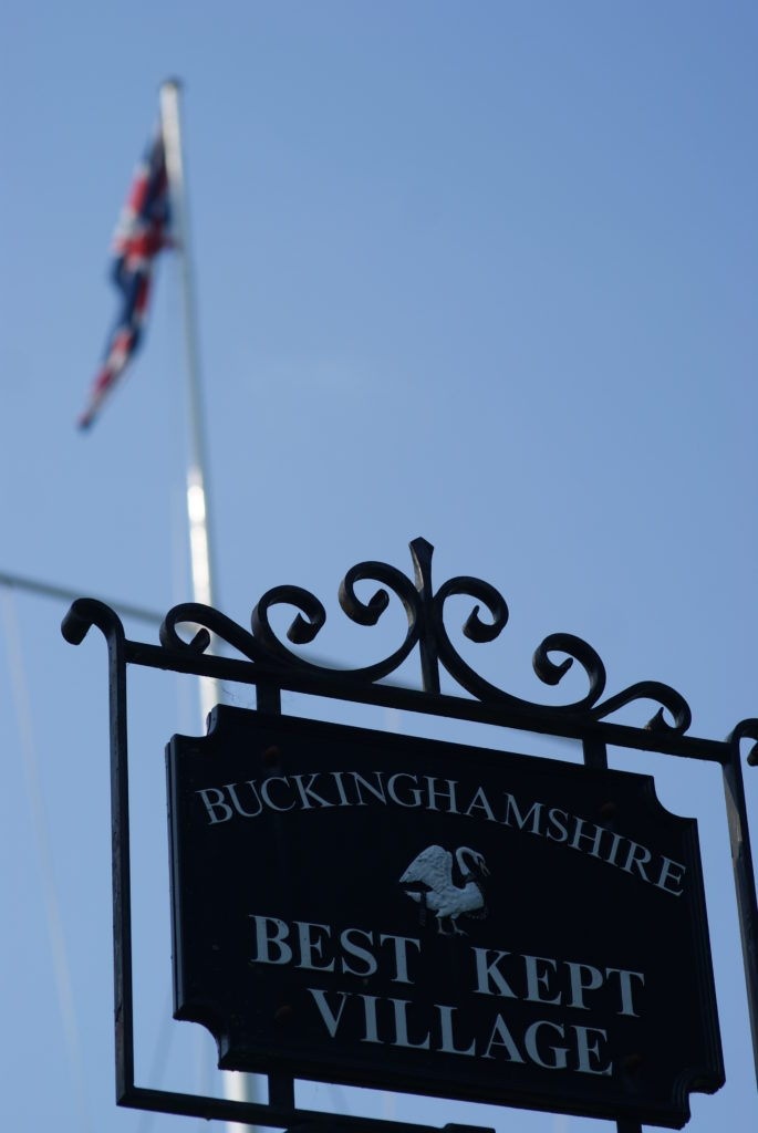 The British flag behind the signpost for Marlow