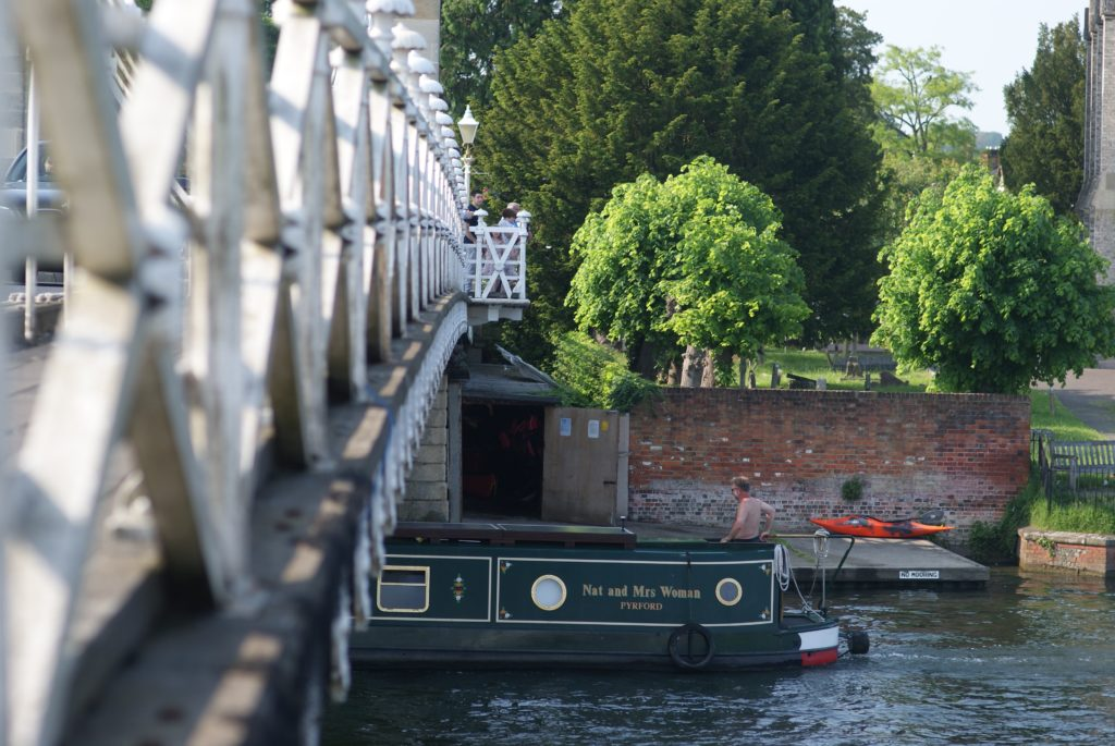 boaters passing under Marlow bridge