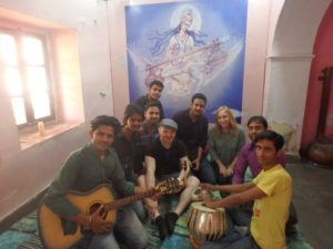 A group of people playing Indian instruments, one of the most unexpected discoveries of the trip