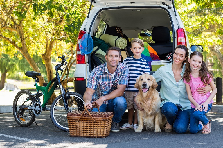 Pet travel - family with dog getting ready for a holiday