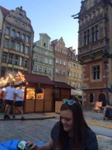 Pouring cider into a glass on Wroclaw's main square where there is a pop up beach