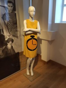 Bright yellow shift 1960s shift dress with a picture of a clock on the front