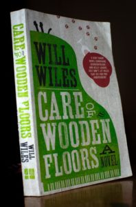 Photo of front cover of a paperback copy of the 'Care of Wooden Floors' by Will Wiles