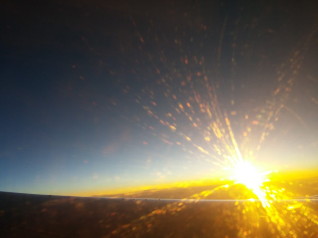 View of the sunrise over Europe through the plane window