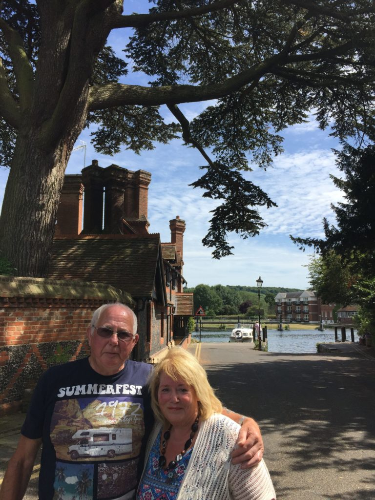 mary and ray housesitters from HouseSitMatch with view of Marlow in the background